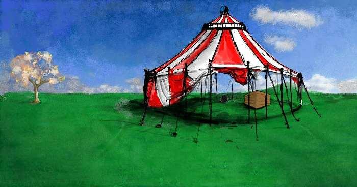 Ein gemaltes Zirkuszelt auf einer Wiese